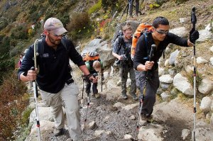 Blind OIF veteran Steve Baskis is verbally guided up a slope by US Army veteran Ike Isaacson in Nepal
